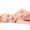 Masseuse massaging little baby girl, shallow focus